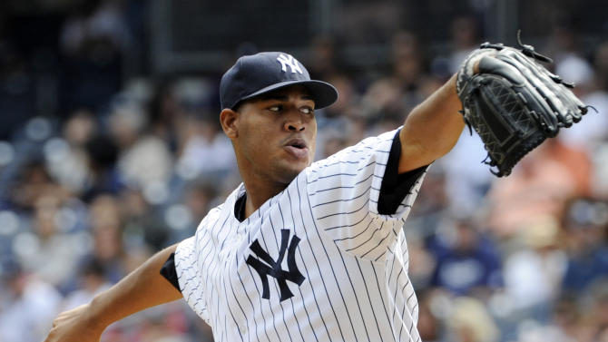 New York Yankees pitcher Ivan Nova delivers to the San Francisco Giants during the first inning of an inter-league baseball game Saturday, Sept. 21, 2013, at Yankee Stadium in New York