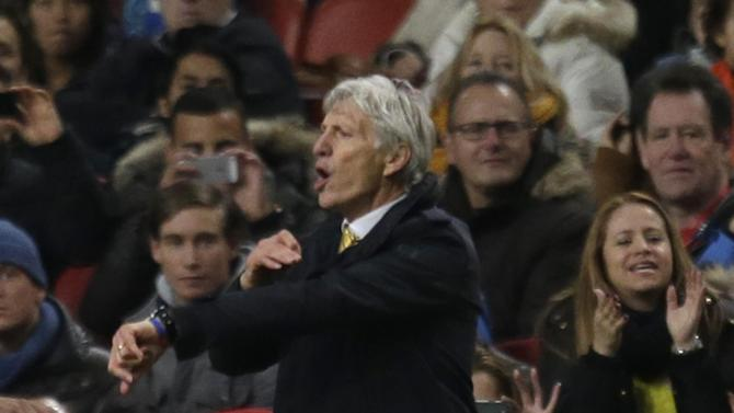 Colombia's coach Jose Nestor Pekerman tells one his players to take captain's armband after substituting his player Falcao Garcia during the international friendly soccer match between Netherlands and Colombia at ArenA stadium in Amsterdam, Netherlands, Tuesday Nov. 19, 2013