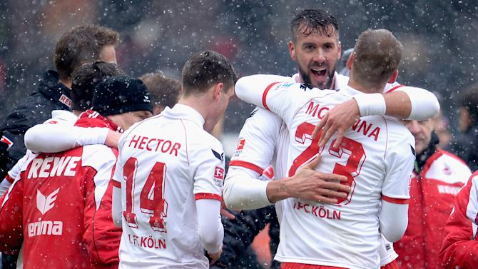 Stefan Maierhofer of Cologne celebrates with teammate Kevin McKenna after the Second Bundesliga match between 1. FC Koeln and Union Berlin at RheinEnergieStadion on February 23, 2013 in Cologne, Germany. (Photo by Dennis Grombkowski/Bongarts/Getty Images)