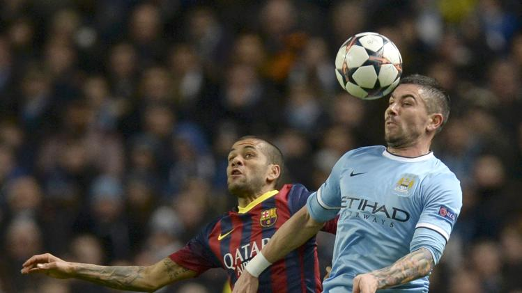 Manchester City's Aleksandar Kolarov challenges Barcelona's Dani Alves during their Champions League round of 16 first leg soccer match at the Etihad Stadium in Manchester