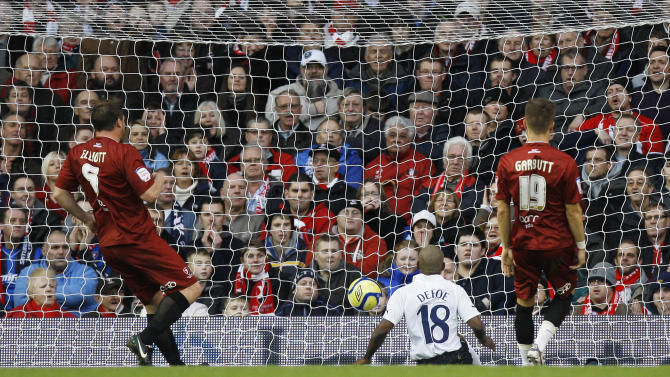 Tottenham's Jermain Defoe, center, scores a goal against Cheltenham during the FA Cup third round soccer match between Tottenham Hotspur and Cheltenham Town at White Hart Lane Stadium in London, Saturday Jan. 7, 2012. (AP Photo/Kirsty Wigglesworth)