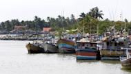 "Sri Lankan boats sit anchored at the fishing harbour of Negombo where many have used similar craft to leave the island illegally and travel to Europe, Australia or New Zealand in search of jobs. Sri Lankan navy officials have urged Australia to deport the growing number of boatpeople arriving from their country, saying it was the ""best way"" to deter people smugglers, a report says"