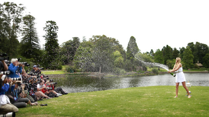 Azarenka of Belarus sprays a bottle of sparkling wine at photographers at the Royal Botanic Gardens in Melbourne