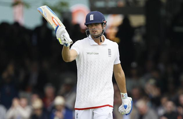 England's Alastair Cook celebrates scoring his 50 during the fourth day of the first Test match between England and New Zealand at Lord's cricket ground in London, Sunday, May 24, 2015. (AP Ph