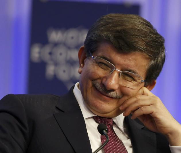 Turkish Foreign Minister Ahmet Davutoglu attends a session at the annual meeting of the World Economic Forum (WEF) in Davos