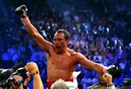 Juan Manuel Marquez celebrates after defeating Manny Pacquiao by a sixth round knockout in their welterweight bout at the MGM Grand Garden Arena, on December 8, in Las Vegas, Nevada