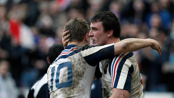 France's Louis Picamoles, right, is congratulated by teammate Jules Plisson, after he scored a try during their Six Nations rugby union international match against Italy, at the Stade de France, in Saint Denis, outside Paris, Sunday, Feb 9, 2014. (AP Photo/Thibault Camus)