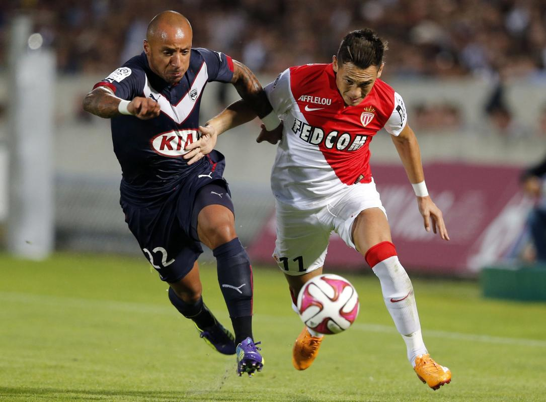 Julien Faubert of Girondins Bordeaux fights for the ball with Lucas Ariel Ocampos of Monaco during their French Ligue 1 soccer match at the Chaban...