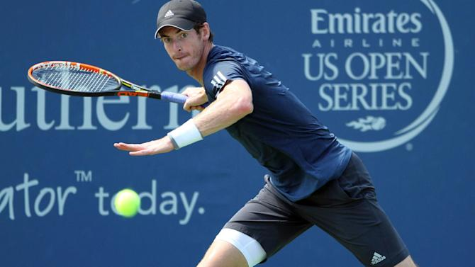 Tennis - Murray moves through, Federer survives scare in Cincinnati
