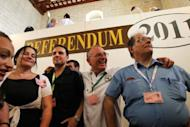 "Members of the Green Party announce the ""yes"" vote in the non-binding referendum to legalise divorce in Malta at a polling station in Valetta. Overwhelmingly Catholic Malta has voted in favour of legalising divorce, Prime Minister Lawrence Gonzi announced Sunday after a referendum in one of the only two countries where it is still banned"