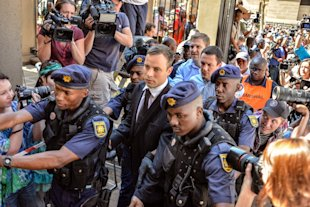 Oscar Pistorius arrives at the High Court in Pretoria on October 21, 2014 (AFP Photo/Mujahid Safodien)