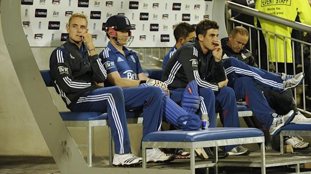 England's captain Stuart Broad (left) looks on from the dugout during the second International T20 cricket match against South Africa (Reuters)