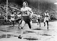 Dutch athlete Fanny Blankers-Koen crosses the finish line to win Olympic gold in the 200m at London's Wembley stadium in July 1948. London is the first city to host a third Olympic Games, but the modest Games of the last century were worlds away from today's glossy extravaganzas