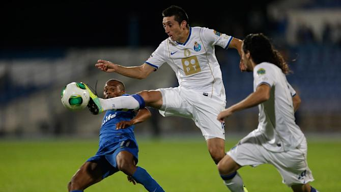 FC Porto's Hector Herrera, from Mexico, controls the ball ahead of Belenenses' Fredy, left, during their Portuguese league soccer match, Saturday, Nov. 2 2013, in Lisbon