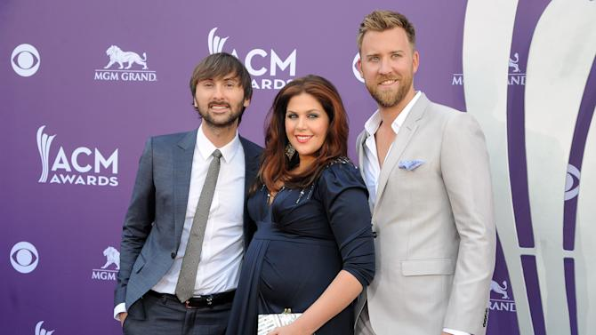 From left, Dave Haywood, Hillary Scott and Charles Kelley, of musical group Lady Antebellum, arrive at the 48th Annual Academy of Country Music Awards at the MGM Grand Garden Arena in Las Vegas on Sunday, April 7, 2013. (Photo by Al Powers/Invision/AP)