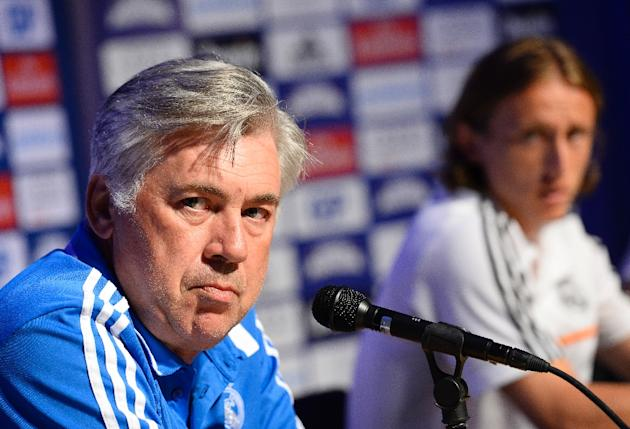 Real Madrid's coach Carlo Ancelotti (L) was accused by Croatia's national team doctor for Luka Modric's (R) latest injury problems