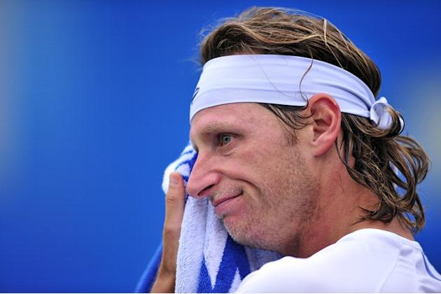 David Nalbandian Of Argentina Wipes AFP/Getty Images