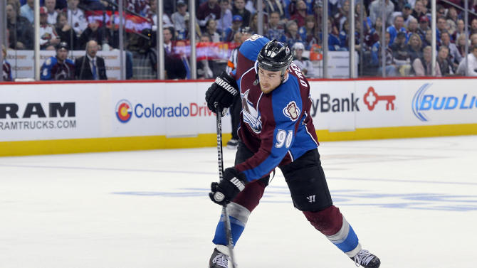 Colorado Avalanche center Ryan O'Reilly (90) shoots a goal against the Minnesota Wild during the second period in Game 1 of an NHL hockey first-round playoff series on Thursday, April 17, 2014, in Denver