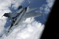 A US Navy FA-18 Super Hornet disconnects from a refuelling tanker during US-Japan military exercise above the South China sea on December 9, 2010. US and Japanese fighter jets have carried out joint air exercises, days after Chinese and Japanese military planes shadowed each other near disputed islands in the East China Sea.