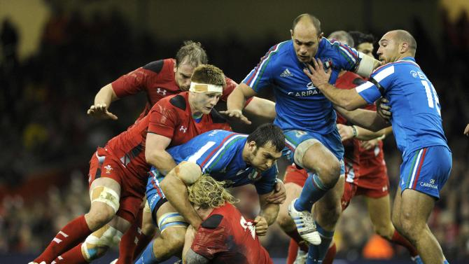 Wales' Richard Hibbard is tackled by Italy's Quintin Geldenhuys during the Six Nations Championship rugby union match at the Millennium Stadium, Cardiff