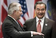 US Secretary of State Rex Tillerson, left, and China's Foreign Minister Wang Yi talk before an opening session meeting of the G20 foreign ministers at the World Conference Center in Bonn, Germany, Thursday, Feb. 16, 2017. Foreign ministers from 20 of the world's leading nations met Thursday in the former German capital to discuss current conflicts and ways to prevent future crises against a backdrop of uncertainty among allies and adversaries about the direction of U.S. foreign policy. (AP Photo/ Brendan Smialowski, Pool)