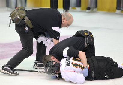 Owen Sound's Joey Hishon on the ice after being hit in the head by an elbow during the 2011 Memorial Cup