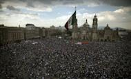 Tens of thousands of demonstrators marched through Mexico City against the presidential election win of Enrique Pena Nieto, accusing him and his party of widespread vote-buying