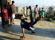 SlumGods members take part in a dance practice at the Sion fort in Mumbai on November 30, 2012. They have inspired hundreds of urban Indian youngsters to try their hands at graffiti, rapping or especially b-boying, a cheap and funky combination of exercise and self-expression