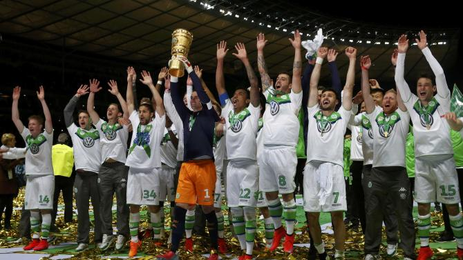 VfL Wolfsburg's goalkeeper Benaglio lifts up the trophy after their German Cup (DFB Pokal) final soccer match against Borussia Dortmund in Berlin