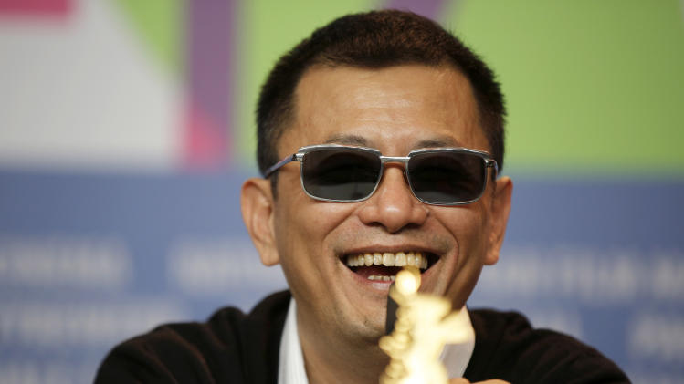 Director Wong Kar Wai smiles during the press conference for the film The Grandmaster at the 63rd edition of the Berlinale, International Film Festival in Berlin, Thursday, Feb.7,2013. (AP Photo/Gero Breloer)