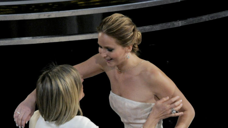 Karen Lawrence, left, congratulates her daughter Jennifer Lawrence after she is announced as the winner of the award for best actress in a leading role for