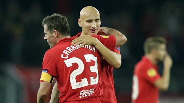 Liverpool's Jamie Carragher (L) and Jonjo Shelvey react after winning against BSC Young Boys during their Europa League Group A match in Bern September 20, 2012.