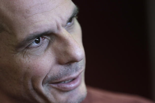 Greece's Finance Minister Yanis Varoufakis speaks during an interview with the Associated Press at his office, in central Athens, on Saturday, Feb. 28, 2015. Varoufakis said that  Greece intends t