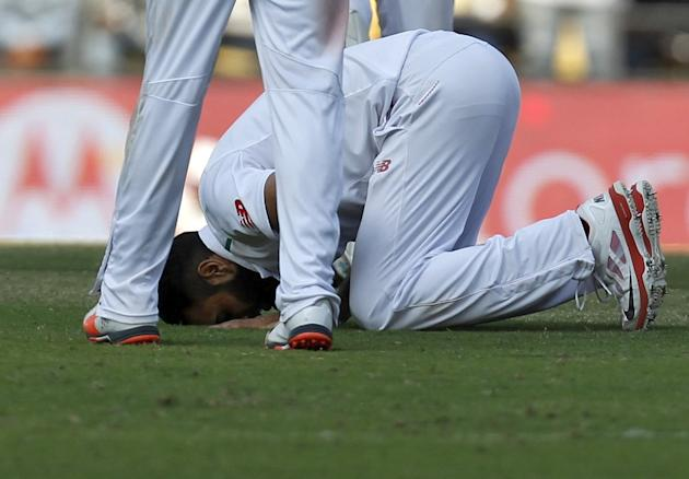 South Africa's Tahir bows down on ground after taking five wickets in India's second innings during the second day of their third test cricket match in Nagpur