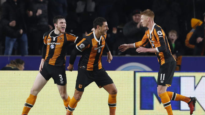 Hull City's Jake Livermore celebrates scoring their third goal with Andrew Robertson and Sam Clucas