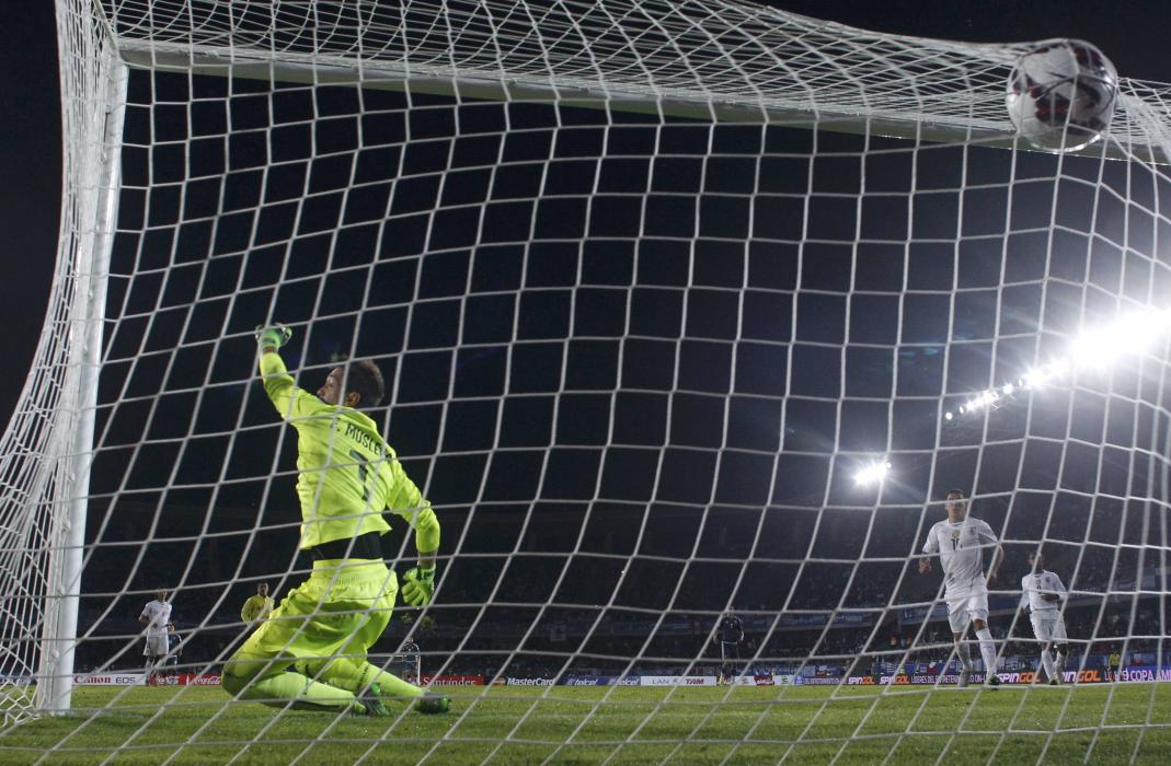Uruguay's goalie Muslera tries in vain to save a goal from Argentina's Aguero during their first round Copa America 2015 soccer match at...
