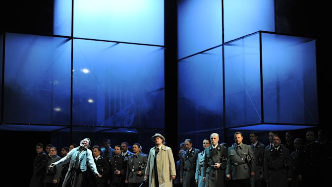 """The photo provided by Deutsche Oper am Rhein in Duesseldorf, western Germany, shows Markus Eiche, left, as Wolfram and Thorsten Gruembel as Landgraf performing in front of the choir in a scene of the the opera 'Tannhaeuser' during the dress rehearsal on April 30, 2013. The modern production of Richard Wagner's opera Tannhauser has caused a stir in Germany because of Nazi-themed scenes showing people dying in gas chambers and a family getting their heads shaved and executed. A spokeswoman for the Duesseldorf opera house said Tuesday that members of the audience """"booed and were shocked"""" by Saturday's, May 3, 2013 opening performance. (AP Photo/Deutsche Oper am Rhein, Hans Joerg Michel) Mandatory Credit"""