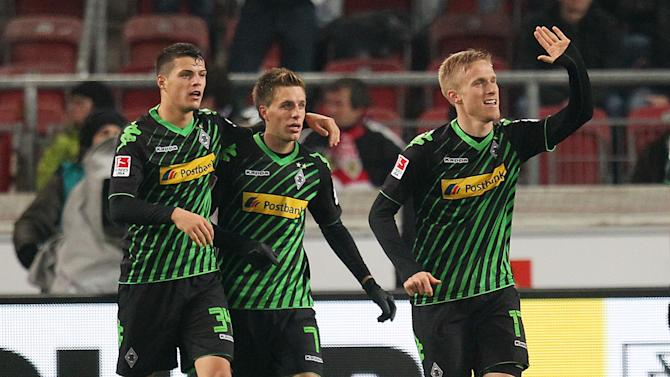 Moenchengladbach's Oscar Wendt of Sweden, right, celebrates his side's second goal challenge for the ball during the German first division Bundesliga soccer match between VfB Stuttgart and Borussia Moenchengladbach Stuttgart, Germany, Friday, Nov. 22, 2013