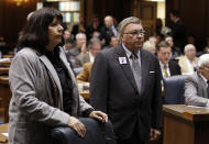 Rep. B. Patrick Bauer, right, D-South Bend, and Rep. Linda Lawson, D-Hammond, call for a caucus as the session began at the Statehouse in Indianapolis, Friday, Jan. 13, 2012. Democrats have proposed a statewide referendum on the right-to-work legislation. (AP Photo/Michael Conroy)