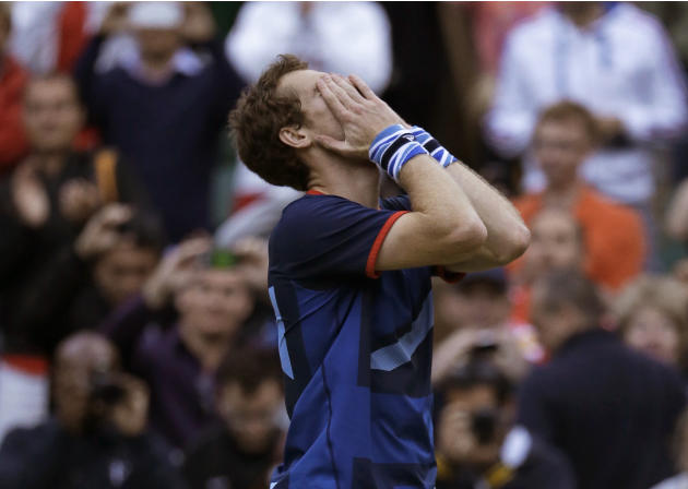Andy Murray of Great Britain celebrates after defeating Novak Djokovic of Serbia at the All England Lawn Tennis Club at Wimbledon, in London, at the 2012 Summer Olympics, Friday, Aug. 3, 2012. (AP Pho