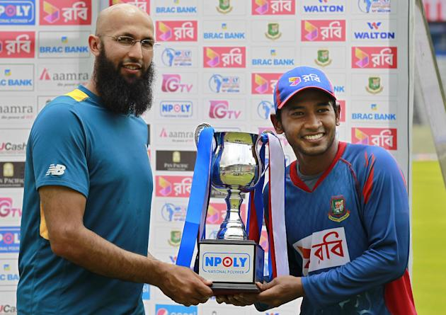 South African cricket team captain, Hashim Amla, left, and his Bangladeshi counterpart, Mushfiqur Rahim, pose with the trophy after a two test match series between the two countries ended in a draw  i