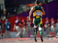 South African Oscar Pistorius makes history by becoming the first double amputee to compete in an athletics event at the Olympics