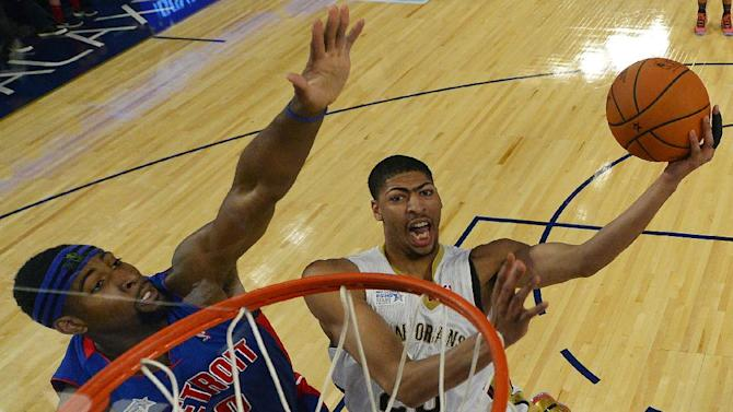 Team Webber's Anthony Davis of the New Orleans Pelicans heads to the basket as Team Hill's Andre Drummond of the Detroit Pistons defends look son during the Rising Star NBA All Star Challenge Basketball game,, Friday, Feb. 14, 2014, in New Orleans
