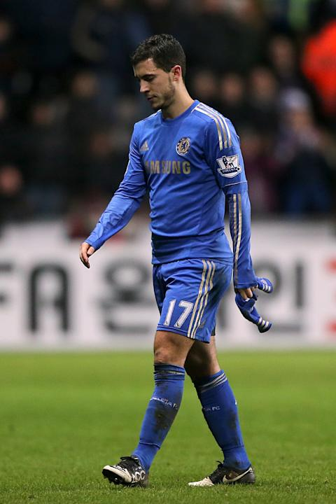 Chelsea's Eden Hazard walks off the field of play dejected after he receives a red card for violent conduct during the English League Cup second leg semi-final soccer match between Chelsea and Swansea