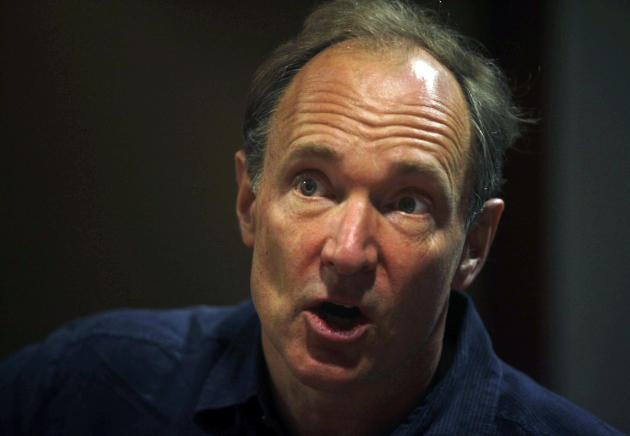 FILE - In this Thursday, March 31, 2011 file photo, World Wide Web inventor Tim Berners-Lee addresses the media during the International World Wide Web conference in Hyderabad, India. The scientists at the European Organization for Nuclear Research, known by its French acronym CERN, are searching for the first Web page. It was there that Berners-Lee invented the Web in 1990 as an unsanctioned project. (AP Photo/Mahesh Kumar A., File)