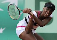 US Venus Williams hits a return to Argentina's Paula Ormaechea during their Women's Singles 1st Round tennis match of the French Open tennis tournament at the Roland Garros stadium, in Paris. Williams won 4-6, 6-1, 6-3
