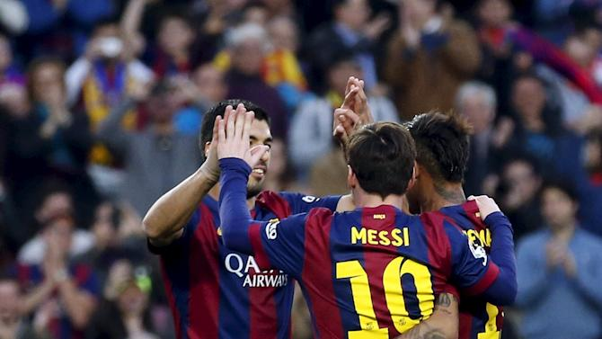 Barcelona's Luis Suarez celebrates his goal with teammates Lionel Messi and Neymar against Getafe during their Spanish first division soccer match at Nou Camp stadium in Barcelona