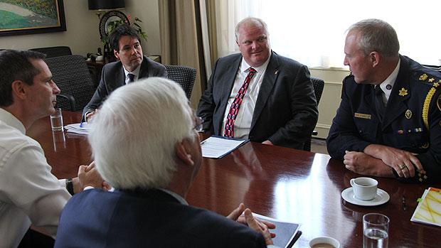 Ontario Premier Dalton McGuinty, left, meets with Toronto Mayor Rob Ford, second from right, to discuss gun violence. Flanking Ford are Minister of Children and Youth Services Eric Hoskins on the left