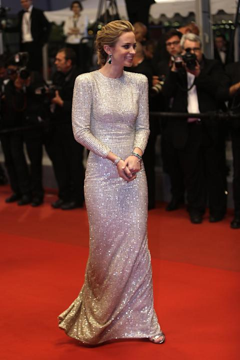 FILE- In this May 19, 2015 file photo, actress Emily Blunt poses for photographers as she leaves following the screening of the film Sicario at the 68th international film festival, Cannes, southern F