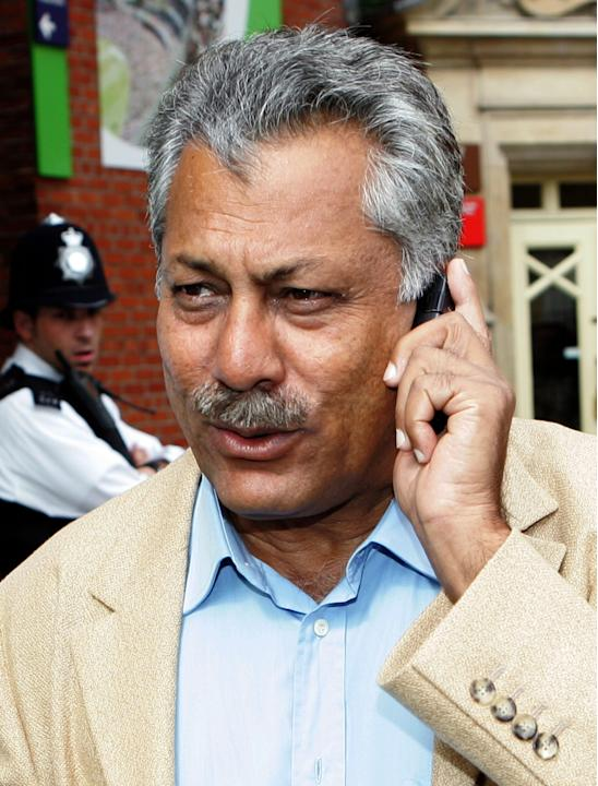 FILE - In this Monday, Aug. 21, 2006 file photo, Pakistan former Test cricketer  Zaheer Abbas speaks on the phone as he walks towards the team bus at the Oval, London, England. The Pakistan Cricket Bo